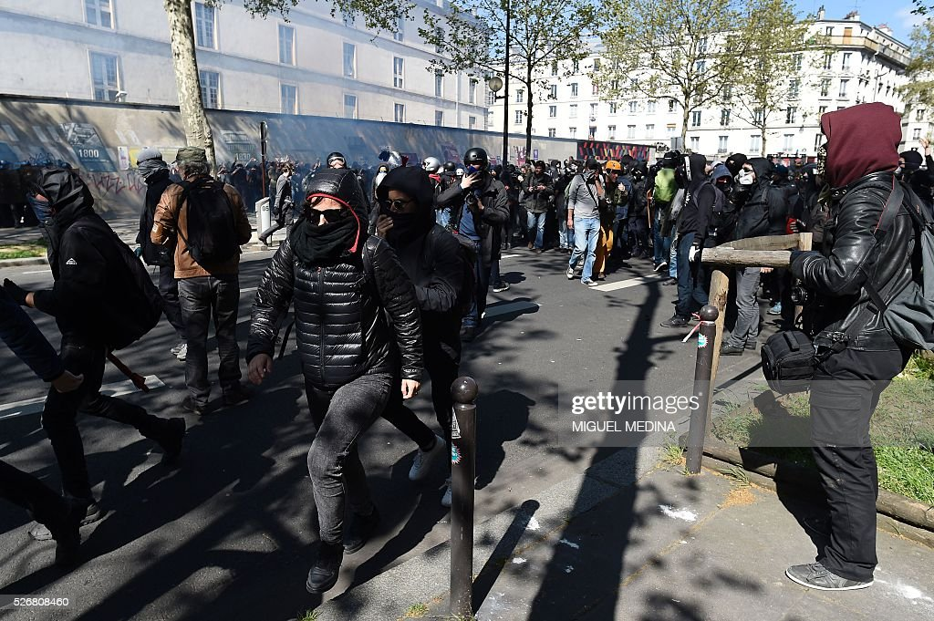 Protesters runs during clashes with police at a traditional May Day demonstration on May 1, 2016, in Paris.