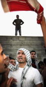 Protesters scale the fortified walls of Palestinian President Yasser Arafat's Muqataa headquarters on November 10 Ramallah West Bank In the event of...