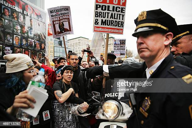 Protesters scuffle with police during a march against police violence in Manhattan on April 14 2015 in New York City A coalation of anti police...