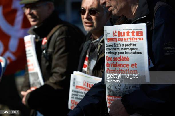 Protesters sell nawpapers of the Lutte Ouvrière trade union during a march in protest against police violence after the alleged rape with a truncheon...
