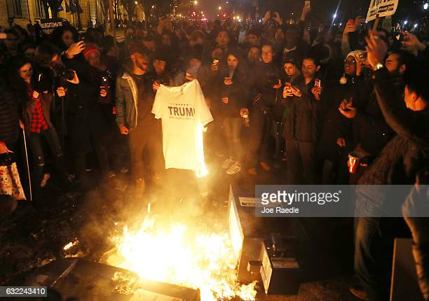 Protesters set a Trump teeshirt on fire in the street as they make themselves heard following the inauguration of President Donald Trump on January...