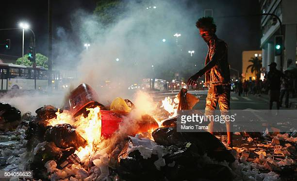 Protesters set fire to trash to block a street during a protest against a hike in public transportation costs on January 8 2016 in Rio de Janeiro...