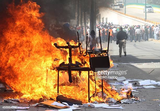 Protesters set on fire the Education Secretarariat's Finance Office in Chilpancingo Guerrero State Mexico on November 12 2014 Demonstrators angry...