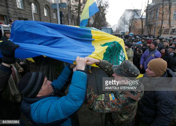 Protesters set up a tent using their national flag during a rally against trade with the occupied territories in Kiev on February 19 2017 More than a...