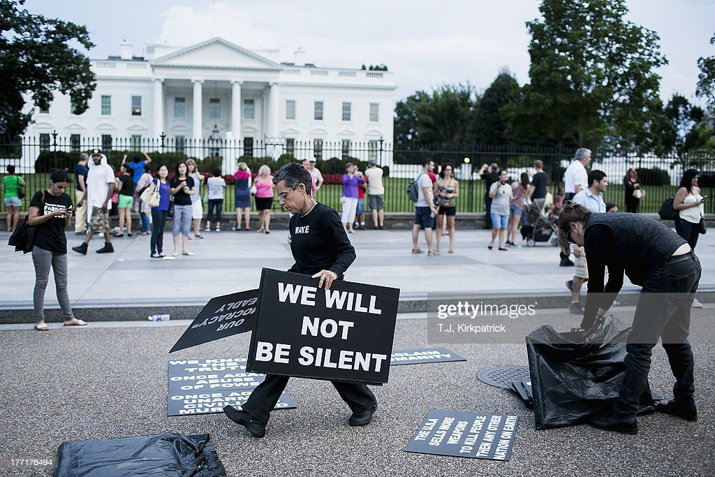 Protesters set up signs at a demonstration in support of Bradley Manning on August 21, 2013 in front of the White House in Washington, DC. Manning was sentenced to 35 years in prison for leaking hundreds of thousands of classified documents to the anti-secrecy group WikiLeaks.