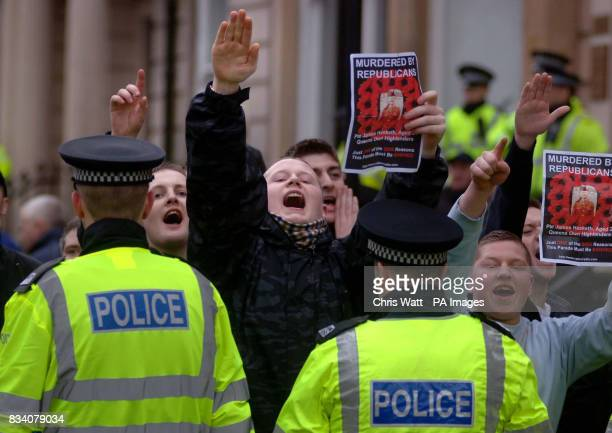 Protesters shout and gesture behind rows of police officers at a parade to remember the victims of Bloody Sunday in Glasgow this morning Around 750...