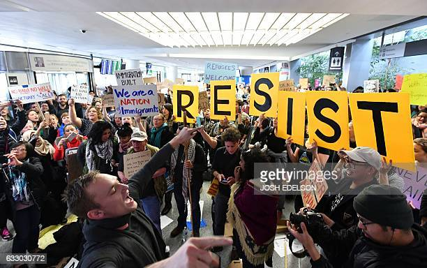 Protesters shout and hold up signs at San Francisco International Airport in San Francisco California on January 29 2017 US US President Donald Trump...
