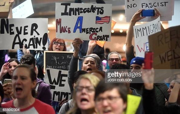 Protesters shout and hold up signs at San Francisco International Airport in San Francisco California on January 29 2017 US President Donald Trump...