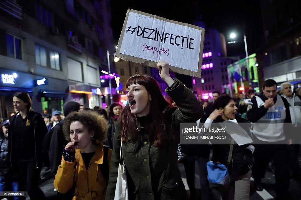 Protesters shout anti corruption slogans during a march in downtown Bucharest on May 6, 2016. Over 500 people gathered in a protest initiated on social media following a journalistic inquiry published this week which expose the corruption from the Romanian health system. The scandal shaking the Romanian public healthcare system brings to the forefront accusations that the Romanian state purchased from public funds diluted disinfectant at very high prices for hospitals across the country. The diluted substances were bought by state hospitals at prices that were even ten times higher. / AFP / DANIEL
