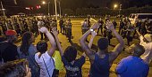 Protesters shout 'Hands up don't shoot' as law enforcement gather before charging the protesters to make arrests on July 10 2016 in Baton Rouge...