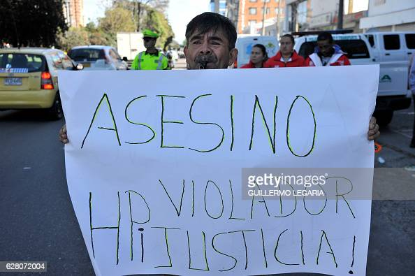 Protesters shout slogans against the alleged murderer of a sevenyearold girl outside the clinic where the suspect is in treatment for a cocaine...