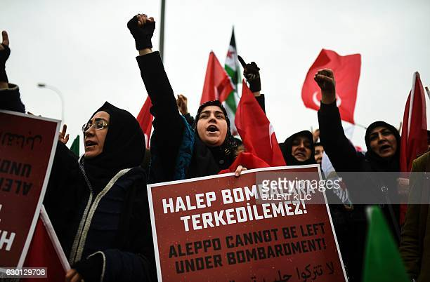 TOPSHOT Protesters shout slogans and hold placards reading 'Aleppo can not be left under bombardment' in Reyhanli in Hatay near the Syrian border on...