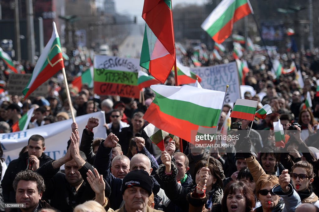 Protesters shout slogans and wave Bulgarian national flags during an anti-monopoly protest in Sofia on March 3, 2013. Tens of thousands of Bulgarians joined new rallies across the country on Sunday to protest against poverty and corruption and denounce the whole political establishment.