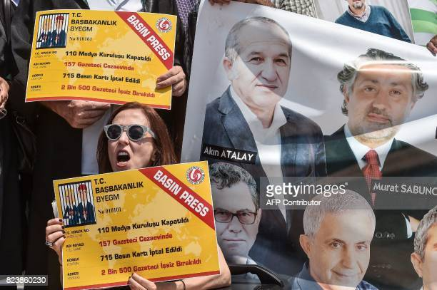 Protesters shout slogans as they hold placards on July 28 2017 during a demonstration in front of Istanbul's courthouse A Turkish court was due on...