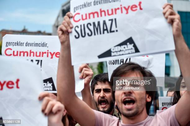 Protesters shout slogans as they hold placards reading 'Cumhuriyet will not be silenced' on July 28 2017 during a demonstration in front of...