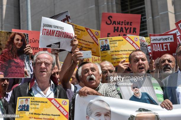 Protesters shout slogans as they hold placards reading ' No to censorship Free journalists' on July 28 2017 during a demonstration in front of...