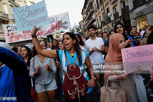 Protesters shout slogans as they hold placards reading 'Welcome refugees' during a demonstration to show solidarity and support for refugees on...