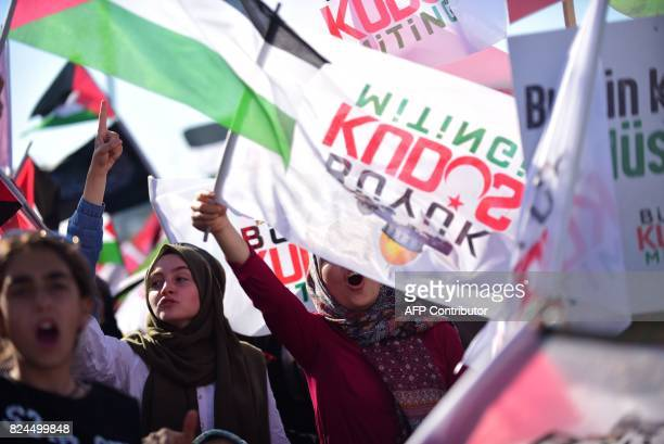 Protesters shout slogans as they wave Turkish and Palestinian flags during a demonstration in Istanbul on July 30 to protest against measures taken...