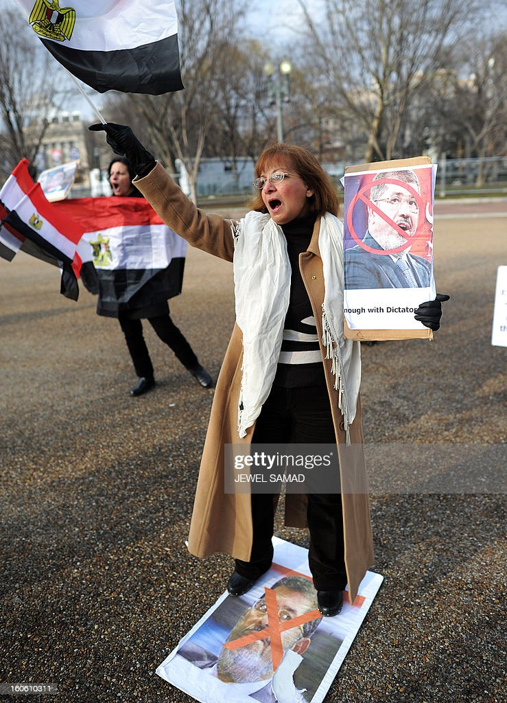 Protesters shout slogans demanding the outster of Egypt's Islamist President Mohamed Morsi during a demonstration in front of the White House in Washington on February 3, 2013. Sporadic clashes broke out overnight between protesters demanding the ouster of Morsi and security forces outside the presidential palace in Cairo on February 3. Since the start of the new wave of violence on January 24, the eve of the second anniversary of the country's 2011 uprising, nearly 60 people have been killed. AFP PHOTO/Jewel Samad