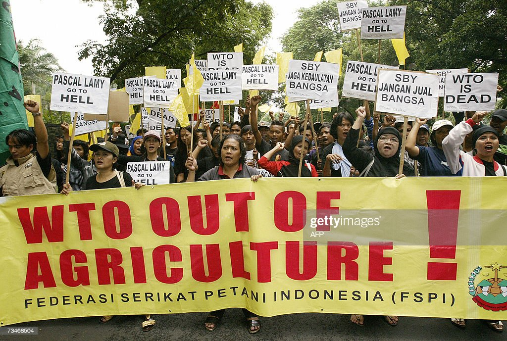 Protesters shout slogans during a demonstration against the World Trade Organization outside a hotel in Jakarta 21 February 2007 Hundreds of...