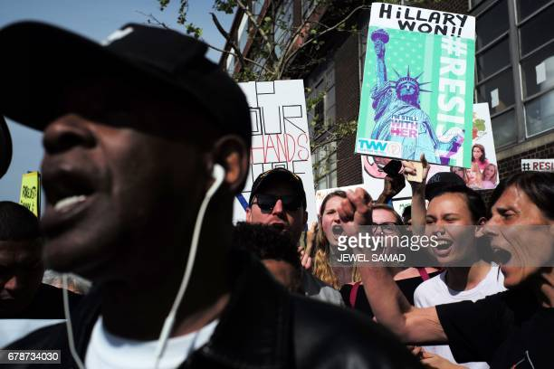 Protesters shout slogans during a demonstration against US President Donald Trump near the USS Intrepid a decommissioned World War II aircraftcarrier...