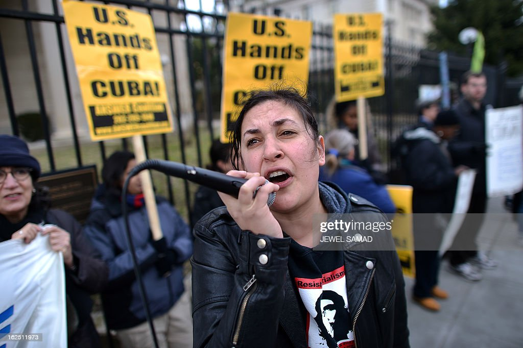 Protesters shout slogans during a demonstration in front of the Cuban Interests Section in Washington, DC, on February 24, 2013. Protesters from different groups took part in the demonstration demanding the release of the 'Cuban Five,' five Cuban intelligence officers who were arrested in Miami on September 12, 1998 and were indicted by the US on 25 different counts, including charges of false identification and conspiracy to commit espionage. In December 2001, the members of the group were sentenced to varying prison terms - two life terms for Gerardo Hernandez, to be served consecutively, life for Antonio Guerrero and Ramon Labanino, 19 years for Fernando Gonzales and 15 years for Rene Gonzales. AFP PHOTO/Jewel Samad
