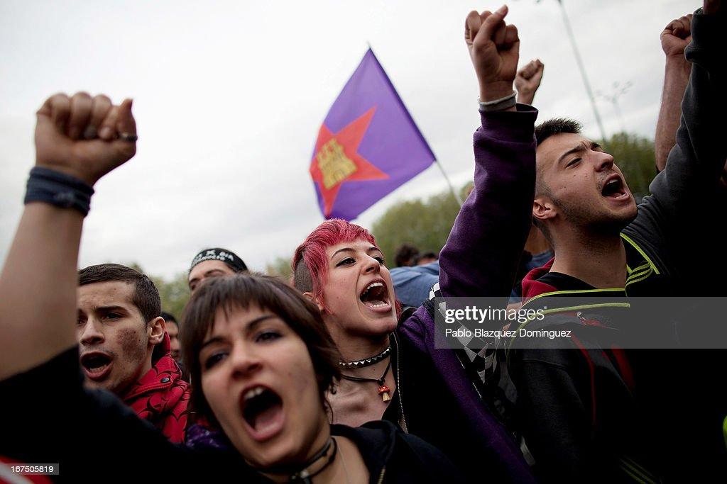 Protesters shout slogans during a demonstration in Neptuno Square on April 25, 2013 in Madrid, Spain. Demonstrators marched from three locations in central Madrid in an attempt to converge on parliament, demanding a constitutional reform and protesting against financial measures introduced by Spanish Prime Minister Mariano Rajoy.