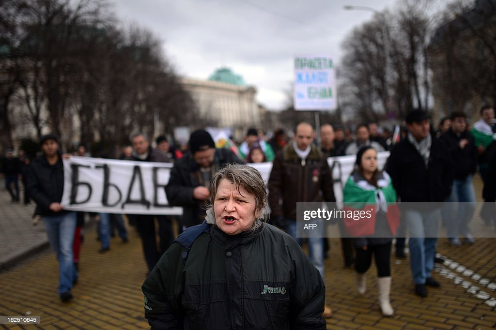 Protesters shout slogans during a protest in Sofia on February 24, 2013. Tens of thousands of protesters rallied across Bulgaria on Sunday to denounce austerity measures and corruption plaguing the country, just days after the right-wing government was forced to resign. AFP PHOTO / DIMITAR DILKOFF
