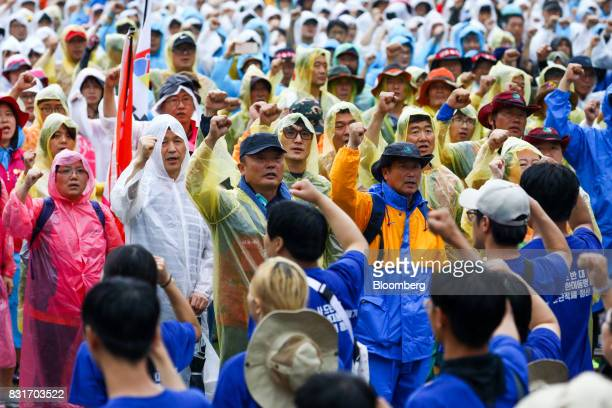 Protesters shout slogans during a rally against the deployment of the Terminal HighAltitude Area Defense system in Seoul South Korea on Tuesday Aug...