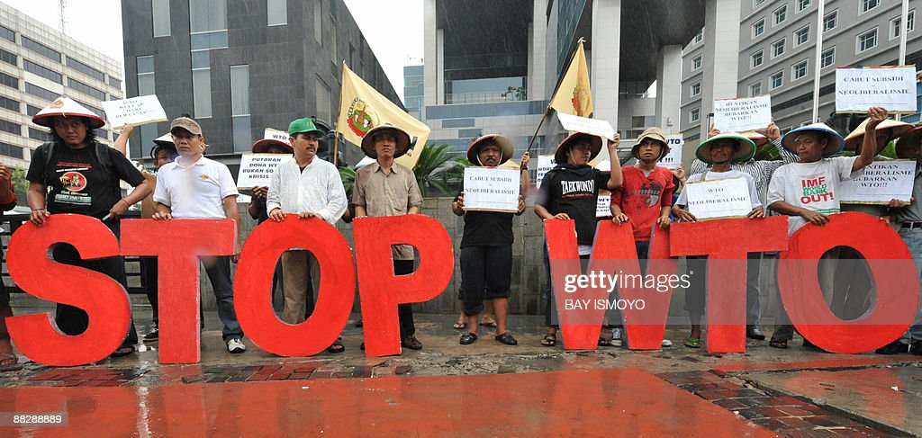 Protesters shout slogans during an antiWorld Trade Organization protest in front of the trade ministry in Jakarta on June 8 2009 US Trade...
