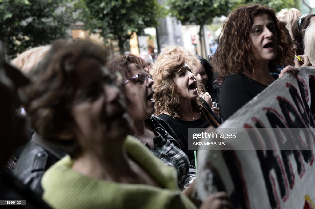Protesters shout slogans outside the Greek Finance Ministry during the meeting of the Greek Finance Minister with the EU and IMF officials in Athens on November 5, 2013. Mission chiefs from the European Commission, the International Monetary Fund and the European Central Bank on November 5 began a new round of talks with members of the debt-wracked Greek government.