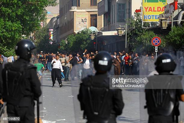 Protesters shout slogans towards security forces during clashes in Sulaimaniyah in Iraq's Kurdistan region on October 10 2015 Thousands of people...