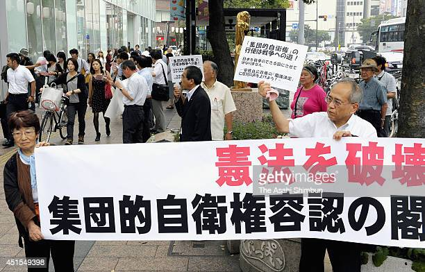 Protesters shout their opposition to the Abe Cabinet's move to allow Japan to exercise the right to collective selfdefense on July 1 2014 in Fukuoka...