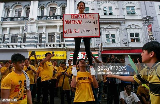 Protesters show a placard near the Merdeka Square during a Bersih rally as protestors call for the resignation of Prime Minister Najib Razak on...