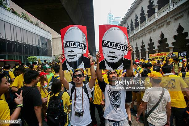 Protesters show placards near the Merdeka Square during a Bersih rally as protestors call for the resignation of Prime Minister Najib Razak on August...