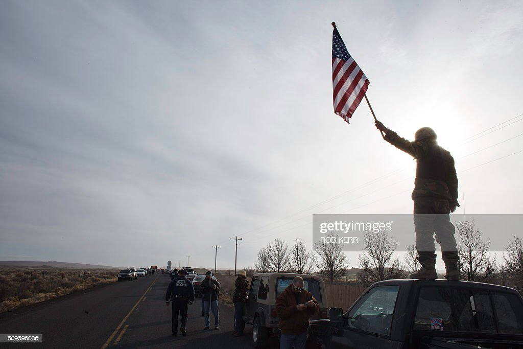 Protesters show their support at the Malheur Wildlife Refuge Headquarters near Burns, Oregon, on February 11, 2016. The FBI surrounded the last protesters holed up at a federal wildlife refuge in Oregon amid reports they will surrender on Thursday, suggesting the weeks-long armed siege is approaching a climax. / AFP / Rob Kerr