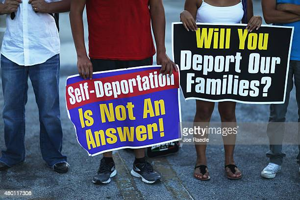 Protesters show their support for the Obama administration's immigration reform plan on July 9 2015 in Homestead Florida The organizers held the...