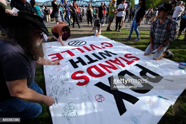 Protesters sign messages of support at a rally on the waterfront in Portland Ore United States on August 18 to show solidarity against hate with...