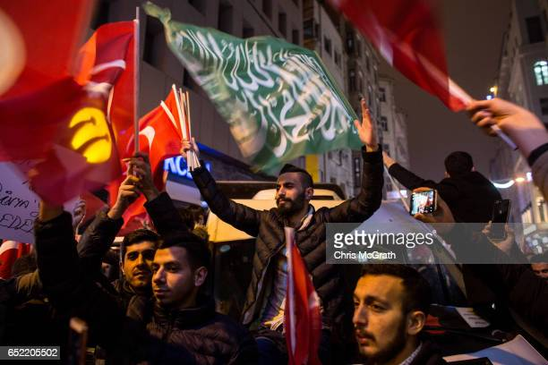 Protesters sing songs and chant slogans outside the Dutch Consulate on March 12 2017 in Istanbul Turkey Protesters gathered outside the consulate...