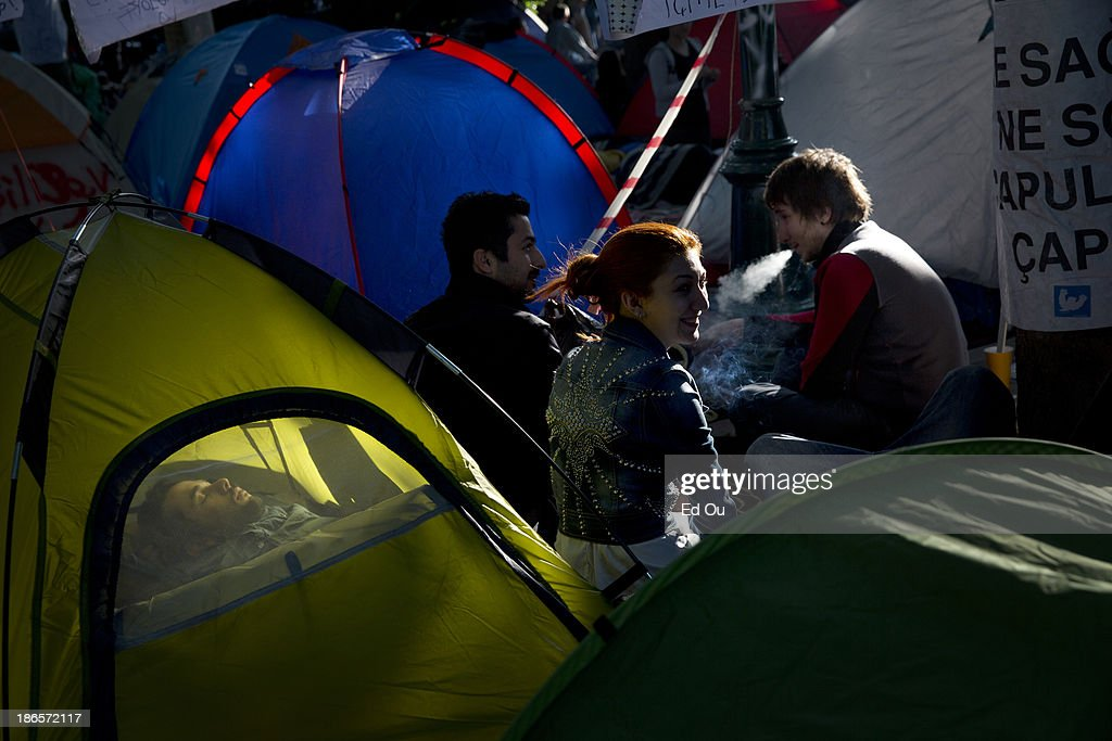 Protesters sleep and talk in their tents in Gezi Park during a sitin in Istanbul Turkey on June 8 2013 Prime Minister Recep Tayyip Erdogan returned...
