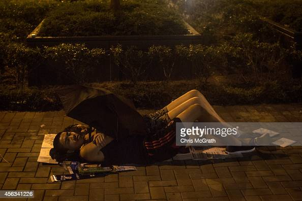 Protesters sleep on the footpath in the early hours of the morning outside the Hong Kong Government Complex on September 30 2014 in Hong Kong Hong...