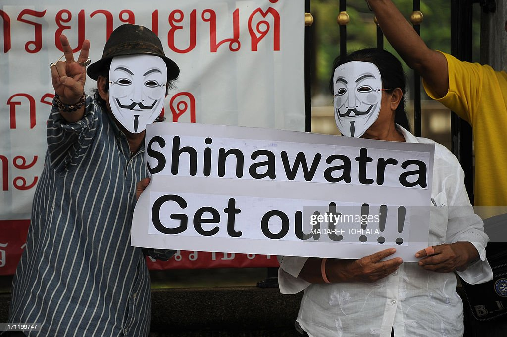 Protesters, some wearing Guy Fawkes masks, gather in Thailand's restive southern province of Narathiwat on June 23, 2013. Hundreds of people gathered to protest against the former prime minister Thaksin Shinawatra and the current government led by his sister Thai Prime minister Yingluck Shinawatra. AFP PHOTO/ MADAREE TOHLALA