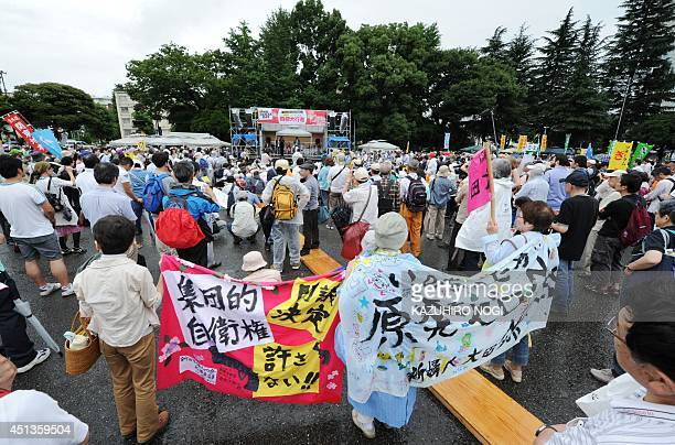 Protesters stage a demonstration in Tokyo on June 28 2014 against reopening the Sendai nuclear power plant operated by Kyushu Electric Power Company...