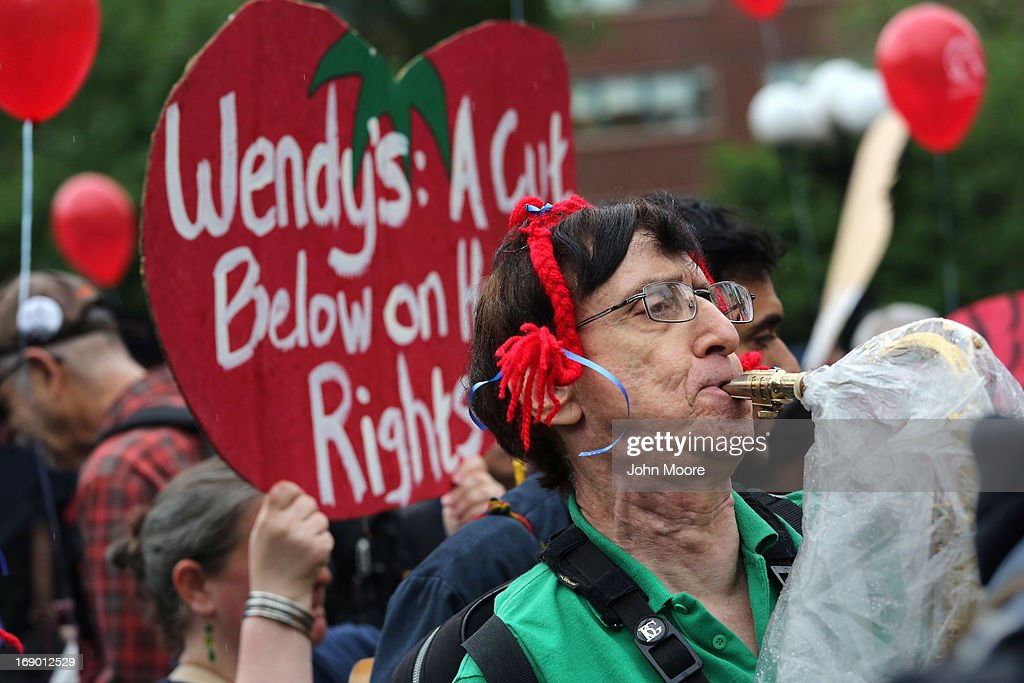 Protesters stage a demonstration near a Wendy's restaurant on May 18, 2013 in New York City. The demonstrators called for the fast food chain to join Florida's Fair Food Program designed to improve wages for tomato pickers in the state. Of the largest fast food corporations in the United States, Wendy's is the only one not participating in the program, according to protest organizers.