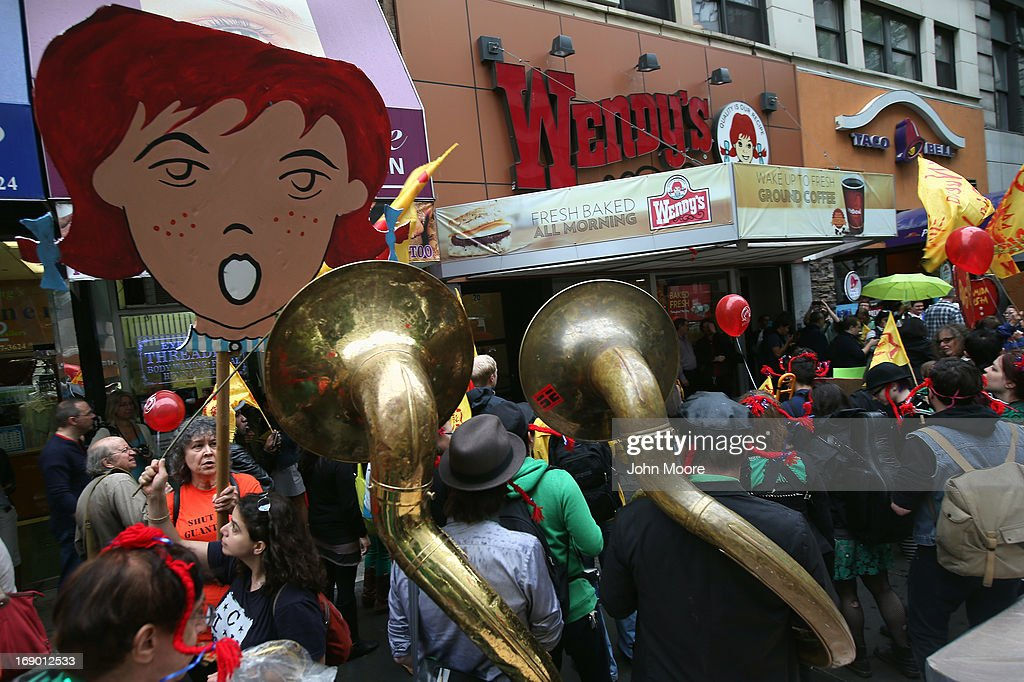 Protesters stage a demonstration outside a Wendy's restaurant on May 18, 2013 in New York City. The demonstrators called for the fast food chain to join Florida's Fair Food Program designed to improve wages for tomato pickers in the state. Of the largest fast food corporations in the United States, Wendy's is the only one not participating in the program, according to protest organizers.