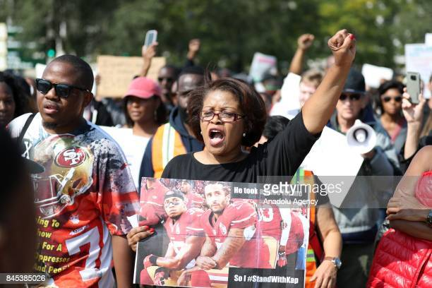 Protesters stage a rally against the National Football League supporting Colin Kaepernick outside the Soldier Field stadium in Chicago United States...
