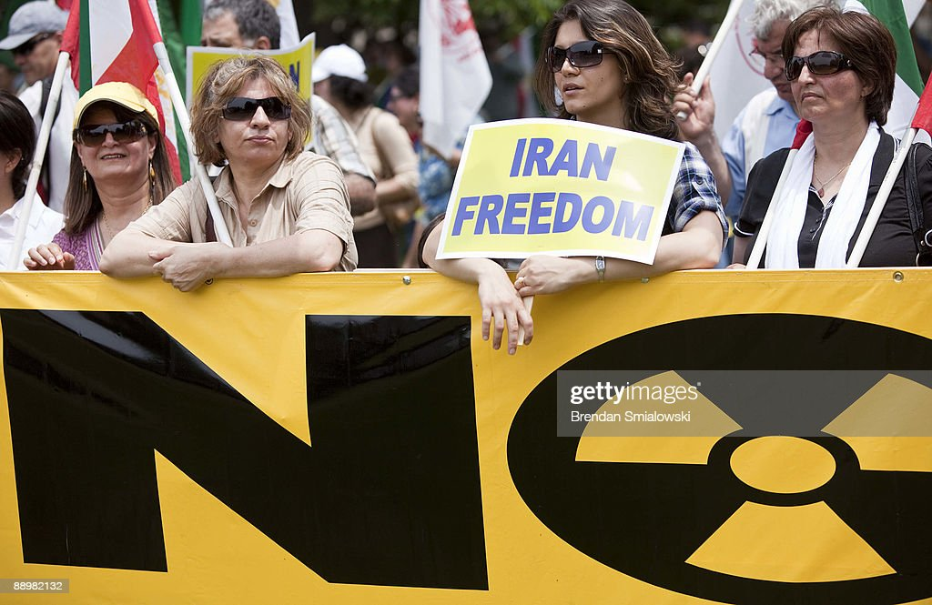 Protesters stand during a rally July 11, 2009 in Washington, DC. Activists gathered to rally for the current uprising in Iran over the recent elections.