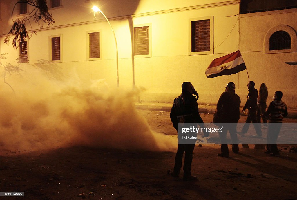 Protesters stand in clouds of tear gas fired by security forces February 2 2012 in Cairo Egypt The protest follows the deaths of 74 football fans who...