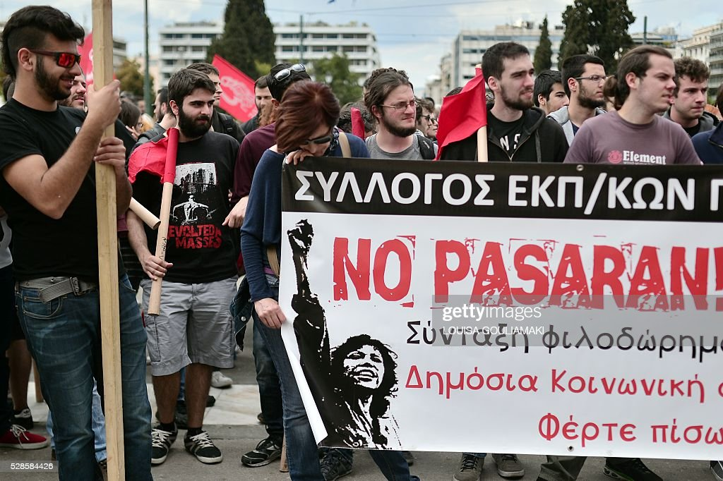 Protesters stand in front of the Greek parliament in Athens , during a demonstration marking a 48-hour general strike, on May 6, 2016. Greece's labour unions stage a two-day general strike to protest controversial government plans to overhaul pensions and increase taxes to meet demands of its bailout creditors . / AFP / LOUISA