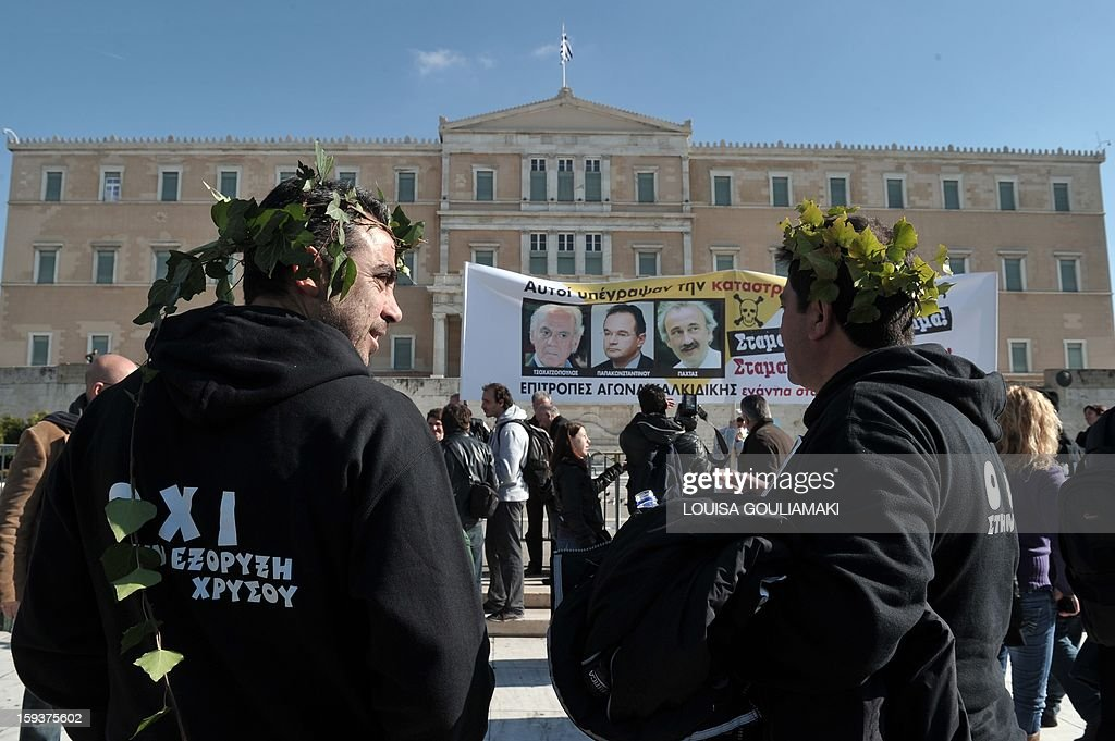 Protesters stand in front of the Greek Parliament on January 12, 2013 in the center of Athens during a demonstration against a Canadian gold mining investment in the northern region of Halkidiki that is feared to be causing irreversible damage to the local environment. A number of citizens' groups, backed by the radical leftist party Syriza that is now the second largest group in parliament, have been trying to scupper the project since 2011, when the government allowed Hellenic Gold -- a subsidiary of Canadian firm Eldorado Gold -- to dig in the area.